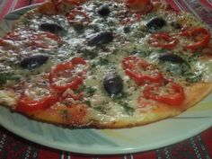 Reteta culinara Pizza rapida la tigaie din categoria Pizza. Specific Romania. Cum sa faci Pizza rapida la tigaie