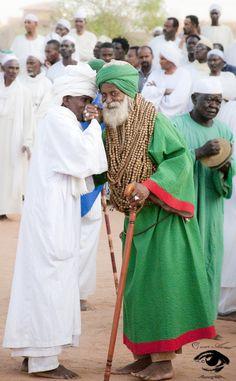 Sudan Sudan. Throngs of men in jalabiyyas--typical Friday afternoon sight.