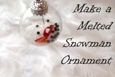 melted snowman glass ornament: Epsom salts, black peppercorns, orange Fimo clay, felt scarf, hat, mittens, two twig arms, ribbon for hanging
