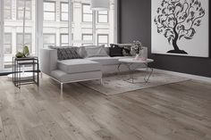 Grey is still trending this year. Here's a pre-finished engineered grey hardwood floor.