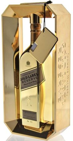 Johnnie Walker Gold Bullion - Stunning piece of Product and Packaging style. The bottle still holds many of the classic Johnnie Walker traits, but become elevated with the grey on gold. Cigars And Whiskey, Scotch Whiskey, Bourbon Whiskey, Alcohol Bottles, Liquor Bottles, Perfume Bottles, Gold Bottles, Cocktail Drinks, Cocktails