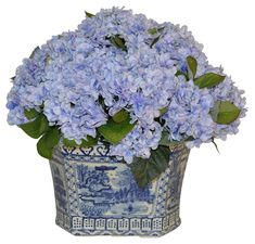 Blue hydrangeas are a statement piece in this chinoiserie planter ($399) from One Kings Lane, which offers a host of other silk blooms, including roses, orchids, and peonies. onekingslane.com