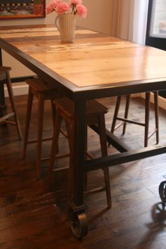 "Bar Height Dining Table on 6"" Caster Wheels with Reclaimed Wood Surface. Seats 10. By Salvage Design Company."