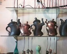 They have teapots similar to this at The Treasure House in Ankeny, Iowa.  They look like they're dancing!