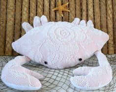 This 3 dimensional crab is made from a pale pink rose patterned chenille bedspread and the underbelly from a polar white fleece fabric. This little fellow measures 15 inches in length and 18 inches wide including the claws. His eyes are 2 bla Nautical Baby Nursery, Nautical Pillows, Chenille Bedspread, Etsy Shipping, Plush Animals, Coastal Living, Plushies, Pale Pink, Handmade