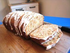 Spiced Carrot Bread - oil - 8 eggs - buttermilk - vanilla extract - sugar - shredded carrot - 8 cups flour - cinnamon - lemon - ground ginger - nutmeg - ground cloves - powdered sugar