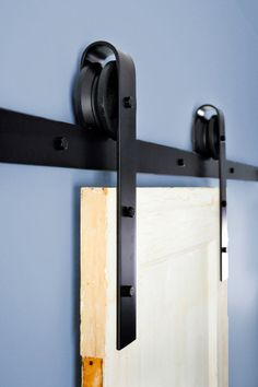 Barn doors in the house. Traditional barn door hardware in powder coated black
