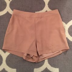 Pink spring shorts-chiffon like material These shorts are perfect for spring. They have a chiffon like texture that makes them comfy and moveable but also a bit dressy. They are a nice pink/rose color. Naked Zebra Shorts