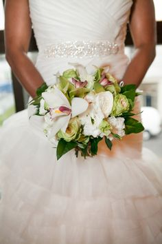 Sweet southern bouquet for our March 27th bride. By Beautiful Flowers bu June.  Green orchids, white orchids, magnolia leaves, white roses, green roses, white lisianthus... Dana Laymon Photography