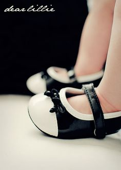 black and white shiny little girl's shoes