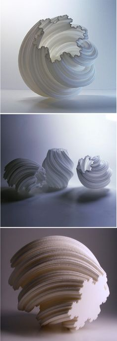 Comprised of more than 800 layers, these elegant spiral vases make for a truly stunning centerpiece.