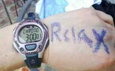 "Annie:  ""This is my unofficial time from Boston.  One of my running buddies always tells me to relax during hard workouts, so I wrote it on my hand to remind myself to relax and on the other hand I wrote enjoy :)"""