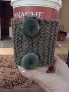 My creative friend Beka made this! Awesome! My first official knitted project (found the inspiration on pinterest), a coffee sleeve with buttons. It took a few tries, but I'm pleased with my effort. It's so soft and cozy on my coffee cup, and good for the environment to boot.