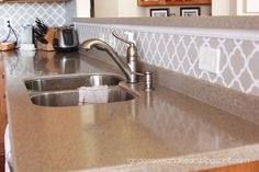 Adhesive backsplash... inexpensive way to spruce up kitchens, bathrooms, etc. Love the pattern too