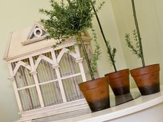 The use of garden accents, wicker, and iron furniture enhances the cottage style in the living room.