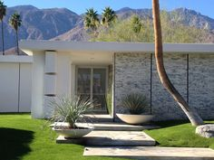 Classic mid-century modern Palm Springs. Great planters!