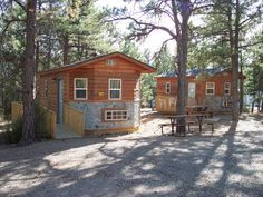 The Hot Springs KOA has two deluxe cabins with bathrooms that can sleep up to 4 people.  There is a queen size bed, futon that folds out to make a full-size bed, small table w/chairs, deck w/ chairs, AC / heat, BBQ and picnic table.