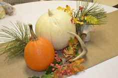 Inexpensive tablescape for autumn breakfast, using all natural elements. Orange and white pumpkins, antlers, long-needle pine, fresh fall foliage with orange berries on burlap table runners. Perfect for father-daughter breakfast--classy and natural.