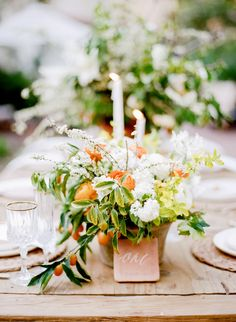A floral Halloween table setup with orange and green colors