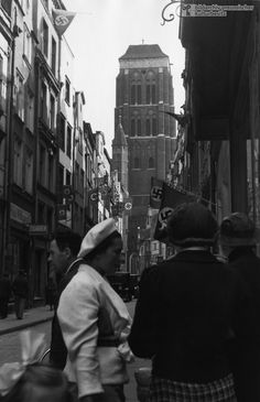 A Danzig Street Decorated with Swastika Flags 1937. The view is from Breitgasse through Korbmachergasse toward the Basilica of the Assumption of the Blessed Virgin Mary. After the end of the WWI, Germany had been forced to cede a strip of land in West Prussia (the so-called Polish Corridor) to Poland. And, the harbor city of Danzig and the surrounding area, with its predominantly German population, was placed under the protection of the League of Nations.