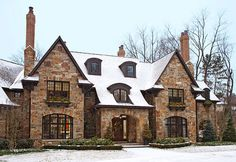 The English Tudor-style house was inspired by the traditional architecture at the nearby Cranbrook estate and school...Traditional Home December 2011