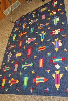 Fun paper-pieced rocket quilt by Cheryl W., as posted on Peas in a Pod.