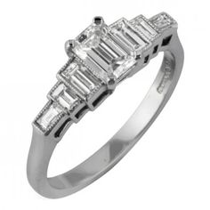 Emerald cut diamond ring with baguette side stones.