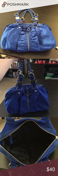 Blue bebe purse Gently used, electric blue. Silver tone hardware. Wrapped chain handles. Zipper closure. Front zipper pocket. Open to trades or offers. bebe Bags Totes