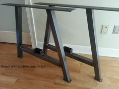 A Frame Metal Table Legs. Available in Raw Steel, Distressed, Black and Silver Powder Coat.  **30+ Yrs Exp - Pride of Work - Good Communication - Reasonable Shipping  This listing is for a pair (2) of table legs.  STANDARD SPECIFICATIONS: • 28H • Choose width between 24 - 32 • 2 x 2 square steel tubing • Narrows from the base to top by approximately 1/3. Example: the 28W - bottom rail narrows to 17 3/8ths wide. • Easy mounting with sturdy 1/4 mounting plate with pre-drilled holes for 1/4 lag…