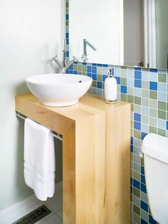 Blue/green tiles behind white sink; design solution for small sink vanity area Small Bathroom Sinks, Vanity, Small Bathroom Solutions, Small Bathroom Vanities, Bathroom Decor, Bathroom Solutions, Bathroom Design, Vanity Design, Small Bathroom Sink Cabinet
