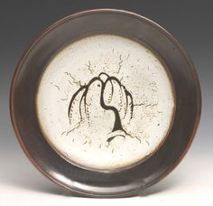 David Leach, (British, 1911-2005) 'willow tree' charger, dolomite over tenmoku glaze, impressed potter's seal, 38 cm