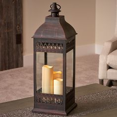 San Nicola Candle Lantern - Bronze: statuesque and elegant. Compliments a variety of styles. Candles operate on 6 hr on / 18hr off timer. Poly construction with real glass. #CandleLantern #Lantern #BatteryPowered #DecorativeLighting