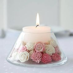 Beautiful glass votive holder filled with flowers. Use Candle Impressions LED votives in stead so they can be left unattended and won't melt away after a few hours of use.