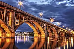 City of Bridges - The lights on the Victoria Bridge as seen from the South Saskatchewan River below the Broadway Bridge in Saskatoon, Saskatchewan, Canada