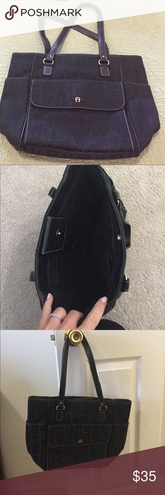 Etienne Aigner black purse GREAT condition. Barely used. Has 2 large side pockets and one large front pocket that has space for cards (a mini wallet!) Etienne Aigner Bags Shoulder Bags
