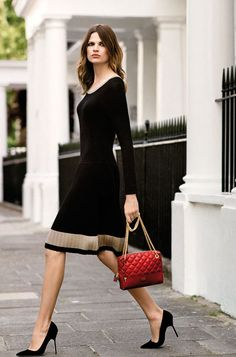 Classic work chic or dinner. black dress, pumps, red handbag.