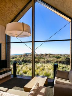 "This New Zealand ""bach"" (a simple vacation home) has a 592 sq ft main level plus…"