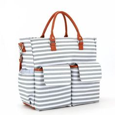 This Large Nautical Canvas Diaper Bag has ample storage compartments for bottles, diapers, snacks, toys and valuables. - Made from sturdy Canvas and PU leather - Four internal mesh pockets in large main compartment - One zipped internal pocket - Insulation pocket to keep bottles warm or cool for up to 4 hours. - Two external flapped pockets - Two external bottle pocket - Changing mat - External side zipped pocket for tissues - Wipeable linings throughout - Available in two colours Item…