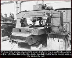 Production of Tiger I at Henschel factory:  Workers make precise alignments to ensure the turret ring is marchined accurately by the vertical two-tool lathe. Note the jig inserted into the towing shackle holes at the front of the hull.