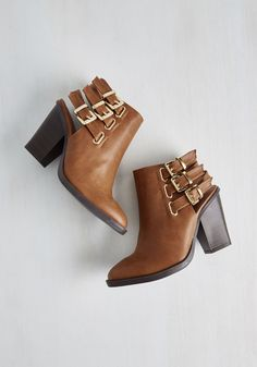 Citywide Open Spaces Bootie. While you love the pulse of the urban jungle, hopping from park to park in these heeled booties is your favorite pastime. #brown #modcloth