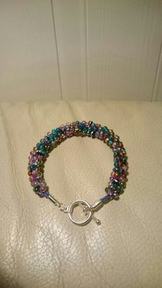 Rainbow beads on kumihimo