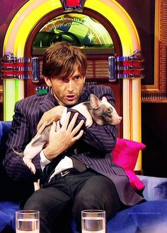 David Tennant with a tiny pig! @Kiah Wagner Wagner Wagner Wagner Finchum