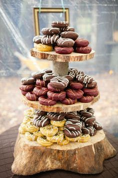 Throwing an autumn fête in a lofty barn? Present donuts (these multi-flavored confections were created by Paulette's Chicken & Donuts!) on a rustic tree-stump stand for an on-theme dessert station. Doughnut Wedding Cake, Wedding Donuts, Small Wedding Cakes, Wedding Cake Designs, Wedding Ideas, Wedding Planning, Wedding Inspiration, Bridal Shower Desserts, Wedding Desserts