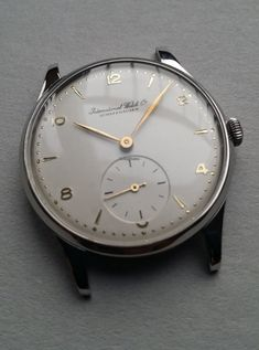 IWC Portuguese ad: $4,607 IWC Portuguese style Cal. 88 35mm (ultra rare + fully serviced) Steel; Manual winding; Condition 1 (mint); Year ca. 1952; With box; Location: Switzerland, Nort