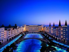 """Hotel Mardan Palace Antalya (Antalya, Turkey) The outdoor pool is more than impressive, with an area of 172 square feet. So impressive in fact, that it falls on the list of the largest pools in the world. In the middle of the pool lies a mysterious """"swimming reef"""" with a variety of fish and indigenous species."""