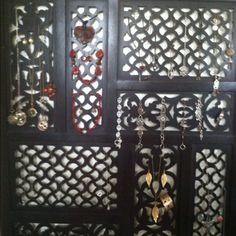 Jewelry organization using a wooden room divider, love it