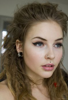 I love the opposites in this look- perfectly classy and polished makeup with grunge hair and piercings.