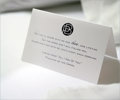 "A monogramed card with lyrics to ""All I Ask of You"" from Phantom of the Opera greets guests in their hotel rooms."