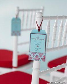 wedding program on chair... that's a good idea
