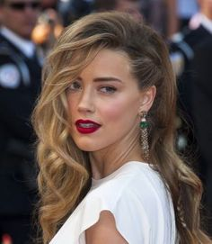 Cannes 2014 : zoom sur le side-hair tressé d'Amber Heard
